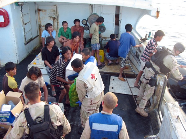 INDIAN OCEAN - Members of a U.S. Navy rescue and assistance team provide humanitarian and medical assistance to the crew of the Taiwanese-flagged fishing trawler Ching Fong Hwa. The vessel had been seized by pirates off the coast of Somalia in early May 2007 and was released Nov. 5, 2007 with U.S. Navy assistance. U.S. Navy photo (RELEASED)