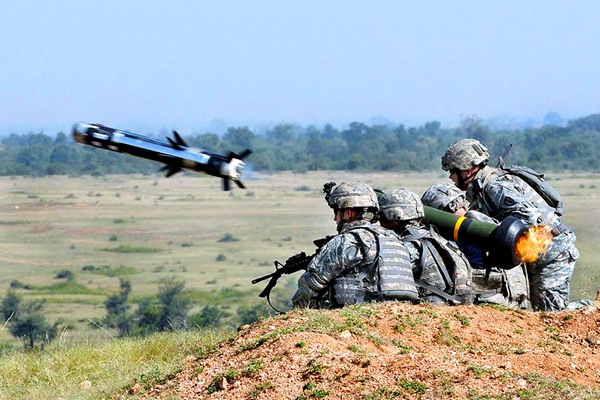 U.S. Army Sgt. Peter Bitter, right, and Sgt. Michael Resendez, fire a Javelin missile for the first time in India during exercise Yudh Abyas on Camp Bundela, India, Oct. 23, 2009. Bitter and Resendez, are assigned to the 25th Infantry Division's 2nd Squadron.