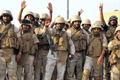 Saudi soldiers in Jizan celebrate their victory over Houthi irregulars following a coordinated air strike and maneuver force military campaign.